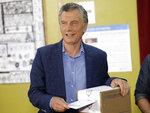 President Mauricio Macri votes in Buenos Aires, Argentina, Sunday, Oct. 27, 2019. Argentina could take a political turn in Sunday's presidential elections, with center-left Peronist candidate Alberto Fernandez favored to oust Macri amid growing frustration over the country's economic crisis.(AP Photo/Daniel Jayo)