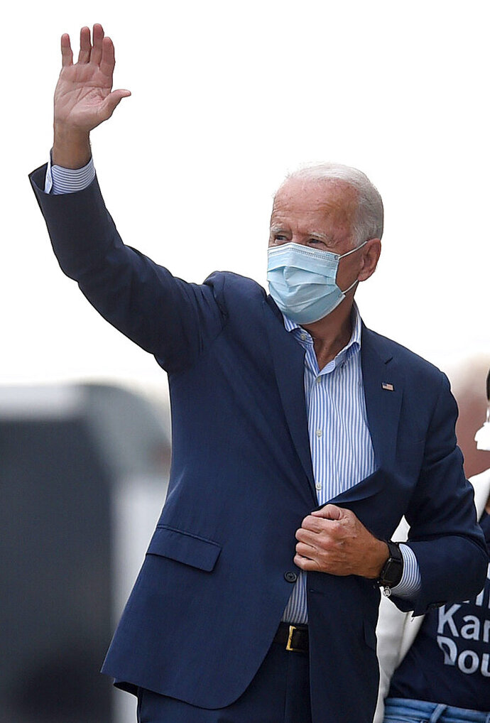 Democratic presidential candidate former Vice President Joe Biden arrives for a tour at the Plumbers Local Union No. 27 training center, Saturday, Oct. 10, 2020, in Erie, Pa. (Jack Hanrahan/Erie Times-News via AP)