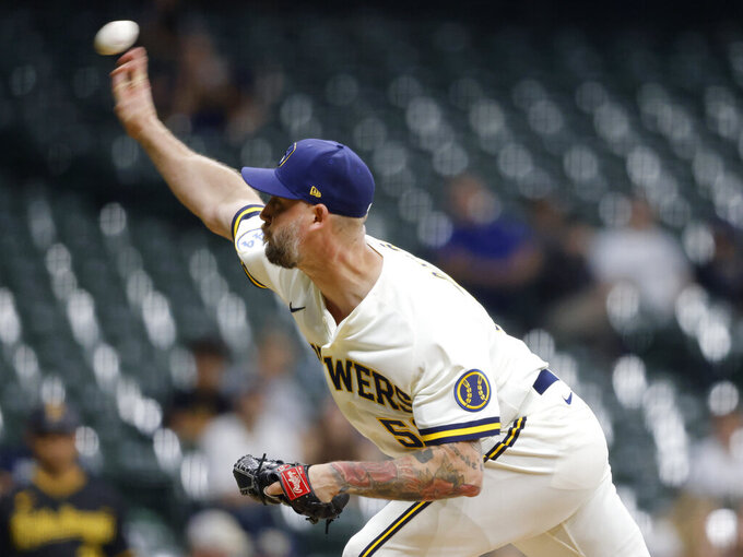 Milwaukee Brewers' John Axford pitches against the Pittsburgh Pirates during the ninth inning of a baseball game Monday, Aug. 2, 2021, in Milwaukee. (AP Photo/Jeffrey Phelps)