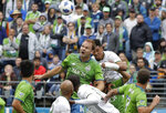 FILE - In this June 30, 2018, file photo, Seattle Sounders' Chad Marshall, center left, and Portland Timbers' Julio Cascante, center right, battle for a header in the first half of an MLS soccer match, in Seattle. Three-time MLS defender of the year Chad Marshall has announced his retirement due to injury, bringing an end to a 16-year career that included stints with the Columbus Crew and Seattle Sounders. Marshall announced his decision Wednesday, May 22, 2019, after missing Seattle's last two games with knee inflammation. (AP Photo/Ted S. Warren, File)