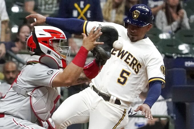 Milwaukee Brewers' Eduardo Escobar scores safely past Philadelphia Phillies catcher Rafael Marchan during the third inning of a baseball game Tuesday, Sept. 7, 2021, in Milwaukee. Escobar scored from second on a hit by Christian Yelich. (AP Photo/Morry Gash)