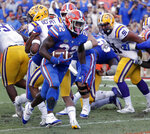 Florida running back Lamical Perine (22) runs past the LSU defense for a 1-yard touchdown during the first half of an NCAA college football game, Saturday, Oct. 6, 2018, in Gainesville, Fla. (AP Photo/John Raoux)