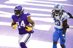 Minnesota Vikings tight end Irv Smith Jr. catches a 9-yard touchdown pass ahead of Detroit Lions cornerback Desmond Trufant, right, during the first half of an NFL football game, Sunday, Nov. 8, 2020, in Minneapolis. (AP Photo/Bruce Kluckhohn)