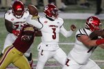 Louisville quarterback Malik Cunningham (3) passes during the first half of an NCAA college football game against Boston College, Saturday, Nov. 28, 2020, in Boston. (AP Photo/Michael Dwyer)