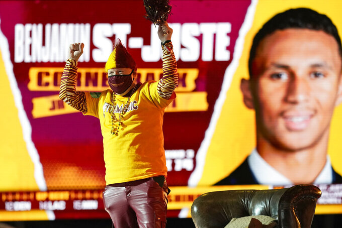 A Washington Football Team fan reacts after Washington picked Minnesota cornerback Benjamin St. Juste, during the third round of the NFL football draft, Friday, April 30, 2021, in Cleveland. (AP Photo/Tony Dejak)