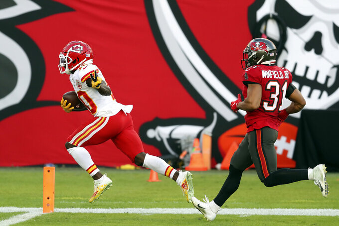 Kansas City Chiefs wide receiver Tyreek Hill (10) reacts as he beats Tampa Bay Buccaneers strong safety Antoine Winfield Jr. (31) on a 75-yard touchdown reception during the first half of an NFL football game Sunday, Nov. 29, 2020, in Tampa, Fla. (AP Photo/Mark LoMoglio)