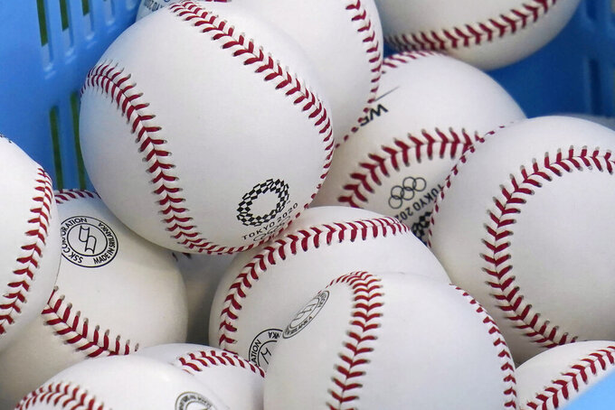A basket of baseball is pictured before a baseball game between Israel and the United States at the 2020 Summer Olympics, Friday, July 30, 2021, in Yokohama, Japan. (AP Photo/Sue Ogrocki)