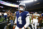 Dallas Cowboys quarterback Dak Prescott (4) walks off the field after an NFL football game against the New Orleans Saints in New Orleans, Sunday, Sept. 29, 2019. The Saints won 12-10. (AP Photo/Butch Dill)