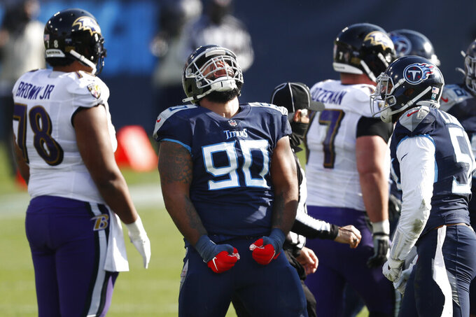 Tennessee Titans defensive end DaQuan Jones (90) celebrates after a play against the Baltimore Ravens in the first half of an NFL wild-card playoff football game Sunday, Jan. 10, 2021, in Nashville, Tenn. (AP Photo/Wade Payne)