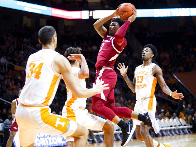 Arkansas guard Desi Sills (3) attempts a shot during an NCAA college basketball game against Tennessee, Tuesday, Feb. 11, 2020 in Knoxville, Tenn. (Brianna Paciorka/Knoxville News Sentinel via AP)