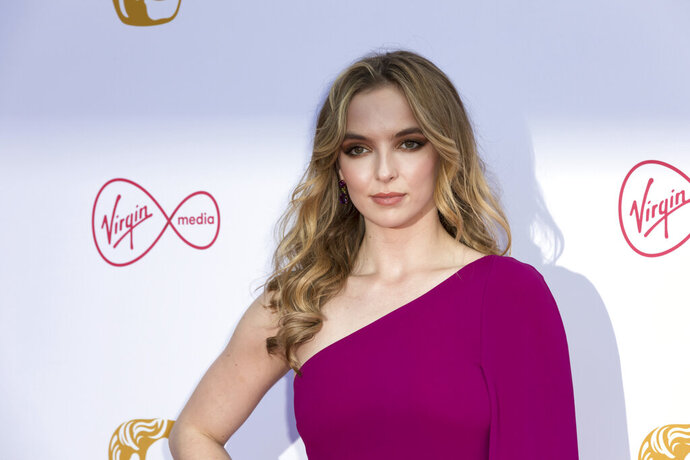 Actress Jodie Comer poses for photographers on arrival at the 2019 BAFTA Television Awards in London, Sunday, May 12, 2019.(Photo by Grant Pollard/Invision/AP)