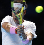 Spain's Rafael Nadal plays a return to Stefanos Tsitsipas of Greece during their ATP World Tours Finals singles tennis match at the O2 Arena in London, Friday, Nov. 15, 2019. (AP Photo/Alastair Grant)
