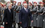 Austrian President Alexander Van der Bellen, left, and Belarusian President Alexander Lukashenko, right, attend a military ceremony ahead of their meeting in Vienna, Austria, Tuesday, Nov. 12, 2019. (AP Photo/Ronald Zak)