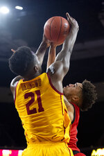 Southern California forward Onyeka Okongwu, left, blocks a shot by Utah forward Timmy Allen during the second half of an NCAA college basketball game Thursday, Jan. 30, 2020 in Los Angeles. (AP Photo/Kyusung Gong)