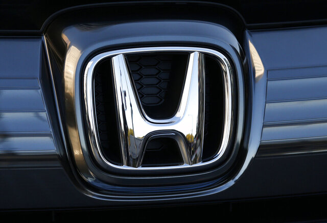 FILE - In this Jan. 11, 2016, file photo, the logo of Honda Motor Co. is seen on a Honda vehicle at the Japanese automaker's headquarters in Tokyo.  Honda, on Tuesday, Aug. 4, 2020,  is recalling over 1.6 million minivans and SUVs in the U.S. to fix problems that include faulty backup camera displays, malfunctioning dashboard lights and sliding doors that don't latch properly.  They cover certain Odyssey minivans from 2018 to 2020, Pilot SUVs from 2019 through 2021 and Passport SUVs from 2019 and 2020. (AP Photo/Shuji Kajiyama, File)
