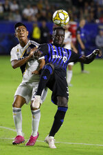LA Galaxy midfielder Efrain Alvarez, left, and Montreal Impact defender Bacary Sagna vie for the ball during the second half of an MLS soccer match in Carson, Calif., Saturday, Sept. 21, 2019. (AP Photo/Chris Carlson)