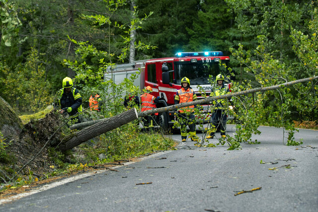 Emergency services at the scene, during high winds, in Ruissalo Turku, southwest of Finland, Thursday, Sept. 17, 2020. The storm called Aila, which first hit along the west coast on Wednesday evening was moving towards the southeast on Thursday morning as winds intensified in the southwest and western inland areas. (Roni Lehti/Lehtikuva via AP)
