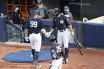 New York Yankees designated hitter Giancarlo Stanton, right, congratulates Aaron Judge (99) after Judge hit a solo home run during an intrasquad baseball game Wednesday, July 15, 2020, at Yankee Stadium in New York. (AP Photo/Kathy Willens)
