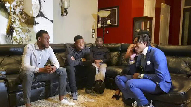 In this still image from video provided by the NFL, Justin Jefferson, right, smiles while watching the NFL football draft Thursday, April 23, 2020, in St. Rose, La. Jefferson was selected by the Minnesota Vikings. (NFL via AP)