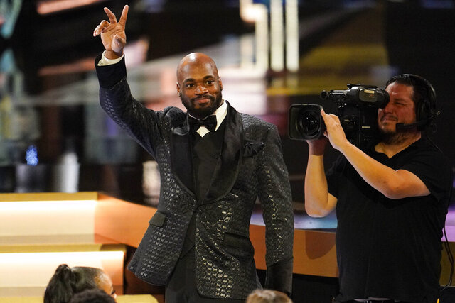 Washington Redskins' Adrian Peterson waves after given the Art Rooney Sportsmanship Award at the NFL Honors football award show Saturday, Feb. 1, 2020, in Miami. (AP Photo/David J. Phillip)