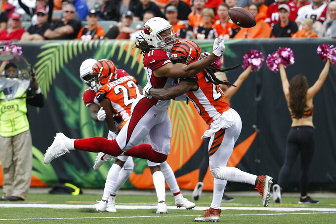 Cincinnati Bengals cornerback B.W. Webb (23) breaks up a pass to Arizona Cardinals wide receiver Larry Fitzgerald (11) in the second half of an NFL football game, Sunday, Oct. 6, 2019, in Cincinnati. (AP Photo/Frank Victores)