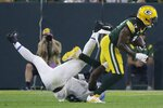Green Bay Packers' Davante Adams gets past Detroit Lions' Jamie Collins during the second half of an NFL football game Monday, Sept. 20, 2021, in Green Bay, Wis. (AP Photo/Mike Roemer)