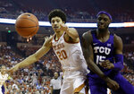 Texas forward Jericho Sims (20) and TCU forward JD Miller (15) chase a loose ball during the first half of an NCAA college basketball game, Saturday, March 9, 2019, in Austin, Texas. (AP Photo/Eric Gay)