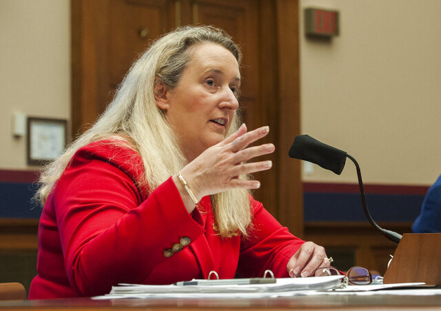 FILE - In this Thursday, May 28, 2020, file photo, Loren Sweatt, Principal Deputy Assistant Secretary, Occupational Safety and Health Administration, testifies before a House Committee on Education and Labor Subcommittee on Workforce Protections hearing examining the federal government's actions to protect workers from the coronavirus, on Capitol Hill in Washington. OSHA said Friday, May 29 that it had issued its first citation in the U.S. related to the coronavirus outbreak: against a Georgia nursing home that delayed reporting the hospitalization of six infected workers. (Rod Lamkey/Pool via AP, File)