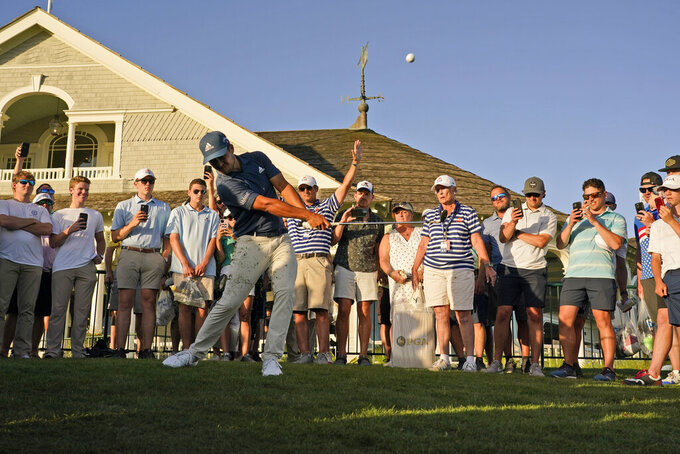 Xander Schauffele chips to the 18th green in the fan area during the second round of the PGA Championship golf tournament on the Ocean Course Friday, May 21, 2021, in Kiawah Island, S.C. (AP Photo/Chris Carlson)