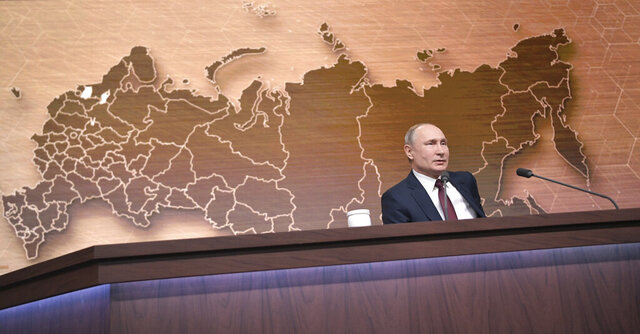 Russian President Vladimir Putin speaks during his annual news conference in Moscow, Russia, Thursday, Dec. 19, 2019. Putin says that global climate change poses new challenges to Russia. Speaking at his annual news conference Thursday, Putin said that global warming could threaten Russian Arctic cities and towns built on permafrost.  (Alexei Druzhinin, Sputnik, Kremlin Pool Photo via AP)