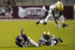Vanderbilt's Randall Haynie (4) leaps to avoid Jaylen Mahoney (23) and Texas A&M's Chase Lane (2) during the second half of an NCAA college football game Saturday, Sept. 26, 2020, in College Station, Texas. Texas A&M won 17-12. (AP Photo/David J. Phillip)