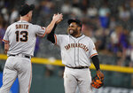 San Francisco Giants relief pitcher Will Smith, left, celebrates with third baseman Pablo Sandoval after Smith struck out Colorado Rockies' Daniel Murphy for the final out of a baseball game Saturday, Aug. 3, 2019, in Denver. The Giants won 6-5. (AP Photo/David Zalubowski)