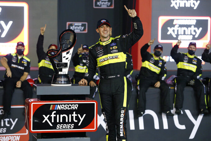 Austin Cindric celebrates in Victory Lane after winning the season championship and the NASCAR Xfinity Series auto race at Phoenix Raceway, Saturday, Nov. 7, 2020, in Avondale, Ariz. (AP Photo/Ralph Freso)