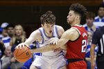 North Carolina State guard Devon Daniels, right, guards Duke forward Matthew Hurt during the first half of an NCAA college basketball game in Durham, N.C., Monday, March 2, 2020. (AP Photo/Gerry Broome)