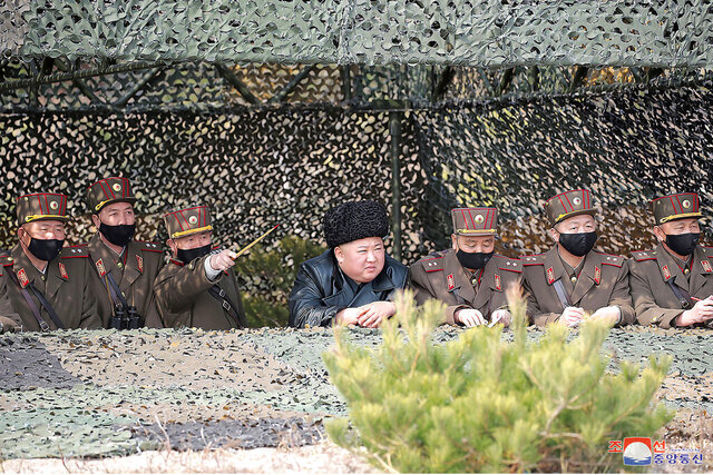 In this Thursday, March 12, 2020, photo provided on Friday, March 13, 2020, by the North Korean government, North Korean leader Kim Jong Un, center, inspects an artillery fire competition in an undisclosed location in North Korea. Independent journalists were not given access to cover the event depicted in this image distributed by the North Korean government. The content of this image is as provided and cannot be independently verified. Korean language watermark on image as provided by source reads:
