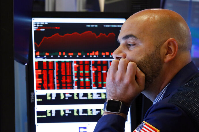 Trader Fred DeMarco works on the floor of the New York Stock Exchange, Friday, Aug. 23, 2019. Stocks tumbled on Wall Street after President Donald Trump said he