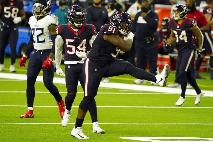 Houston Texans defensive end Carlos Watkins (91) celebrates after sacking Tennessee Titans quarterback Ryan Tannehill during the second half of an NFL football game Sunday, Jan. 3, 2021, in Houston. (AP Photo/Eric Christian Smith)