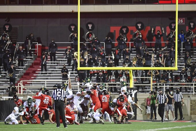Texas Tech place kicker Jonathan Garibay (46) kicks the winning field goal against Baylor in the second half of an NCAA college football game in Lubbock, Texas, Saturday, Nov. 14, 2020. (AP Photo/Justin Rex)