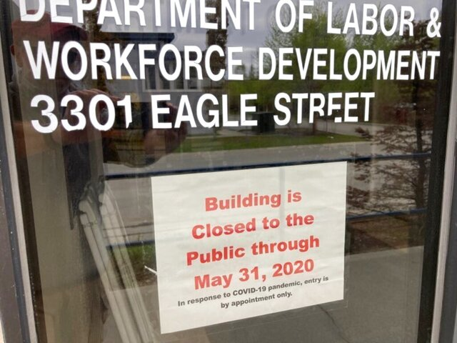 A sign on the door of the state labor department office in Anchorage, Alaska, on Friday, May 22, 2020, shows the office is closed to the public through the end of May. A report released by the department Friday showed the number of jobs in Alaska in April was down sharply compared to April 2019 amid coronavirus concerns. (AP Photo/Mark Thiessen)