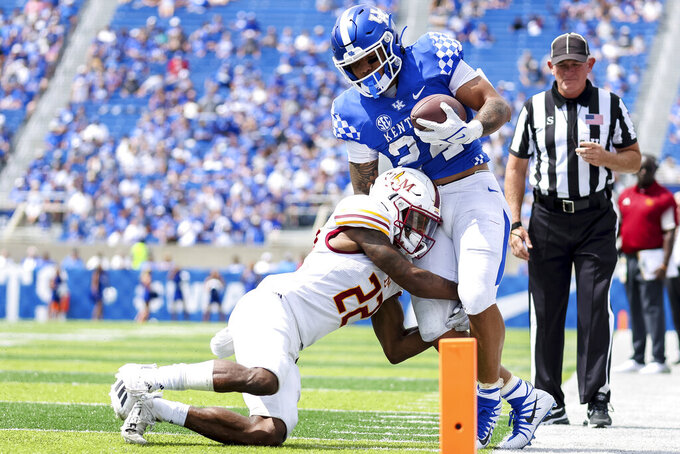 Kentucky running back Chris Rodriguez Jr. (24) gets tackled during the second half of an NCAA college football game against Louisiana-Monroe in Lexington, Ky., Saturday, Sept. 4, 2021. (AP Photo/Michael Clubb)