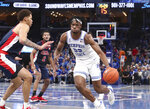 Memphis' Precious Achiuwa (55) drives the ball around Mississippi's KJ Buffen (5) in the second half of an NCAA college basketball game Saturday, Nov. 23, 2019, in Memphis, Tenn. (AP Photo/Karen Pulfer Focht)