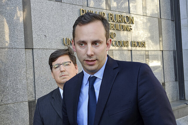 FILE - This Sept. 24, 2019 photo shows former Google engineer Anthony Levandowski, right, in front of his attorney, Miles Ehrlich, outside of a federal courthouse in San Francisco.  President Donald Trump has pardoned Levandowski, who plead guilty to stealing trade secrets before joining Uber's effort to build robotic vehicles for its ride-hailing service. Levandowski was among the more than 140 people included in a flurry of clemency action in the final hours of Trump's White House term.   (AP Photo/Michael Liedtke)