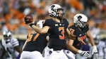 Oklahoma State quarterback Spencer Sanders (3) throws a pass during the first half of an NCAA college football game against Kansas State, Saturday, Sept. 25, 2021, in Stillwater, Okla. (AP Photo/Brody Schmidt)