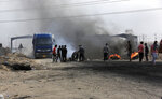 Anti-government protesters re-block the port of Umm Qasr Iraq, Thursday, Nov. 7, 2019.  Iraqi security and medical officials say the country's main port has closed again after brief resumption of services.(AP Photo/Nabil al-Jourani)