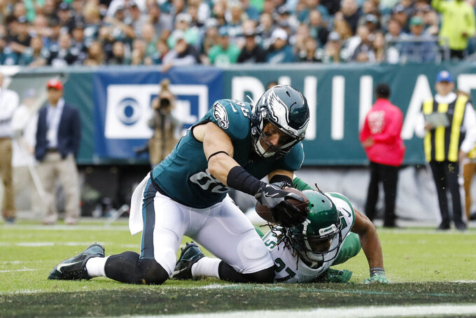Philadelphia Eagles' Zach Ertz (86) scores a touchdown past New York Jets' Darryl Roberts (27) during the first half of an NFL football game, Sunday, Oct. 6, 2019, in Philadelphia. (AP Photo/Michael Perez)