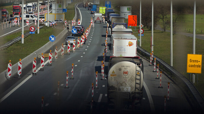 FILE - In this Monday, April 6, 2020 file photo, police perform checks on commercial and passenger traffic on the Dutch-Belgian border, during a partial lockdown to contain the spread of COVID-19 in Meer, Belgium. As European countries struggle to manage spikes in coronavirus cases, concern is mounting about a