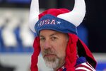 A fan waits for the start of the opening ceremony for the Ryder Cup at the Whistling Straits Golf Course Thursday, Sept. 23, 2021, in Sheboygan, Wis. (AP Photo/Charlie Neibergall)