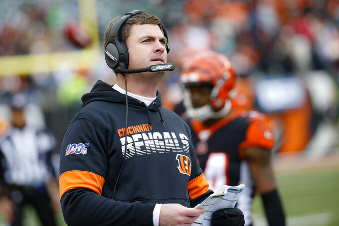 Cincinnati Bengals head coach Zac Taylor works on the sidelines during the second half of an NFL football game against the New York Jets, Sunday, Dec. 1, 2019, in Cincinnati. (AP Photo/Frank Victores)