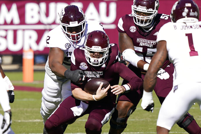 Mississippi State quarterback K.J. Costello (3) is sacked by a Texas A&M defender during the first half of an NCAA college football game in Starkville, Miss., Saturday, Oct. 17, 2020. (AP Photo/Rogelio V. Solis)