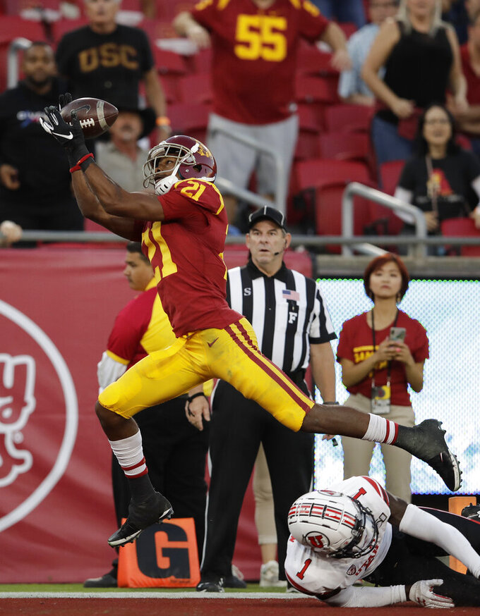 Southern California wide receiver Tyler Vaughns (21) makes a touchdown catch over Utah defensive back Jaylon Johnson (1) during the first half of an NCAA college football game Friday, Sept. 20, 2019, in Los Angeles. (AP Photo/Marcio Jose Sanchez)